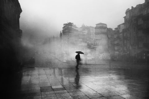 black-and-white-photo-of-man-with-umbrella-3299386