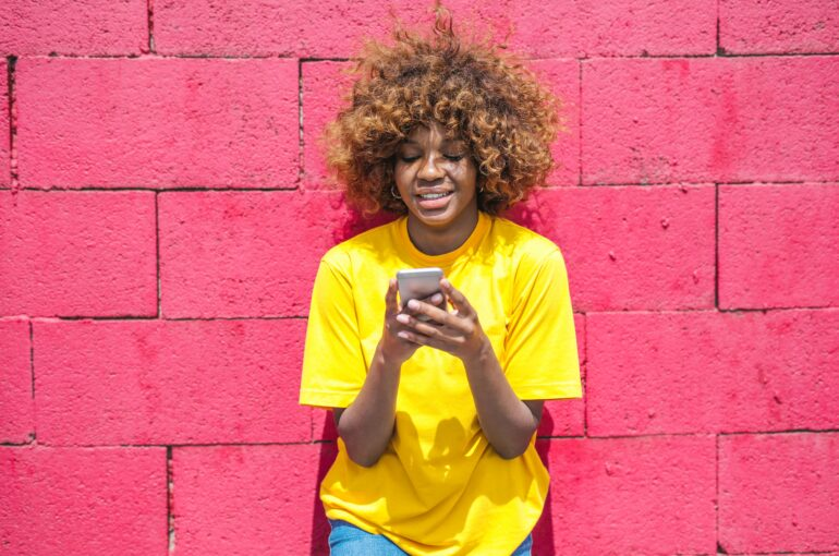 woman-in-yellow-shirt-holding-cellular-phone-3765114 (1)